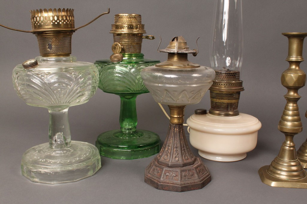 Lot 688A: Grouping of oil lamps and brass candlesticks