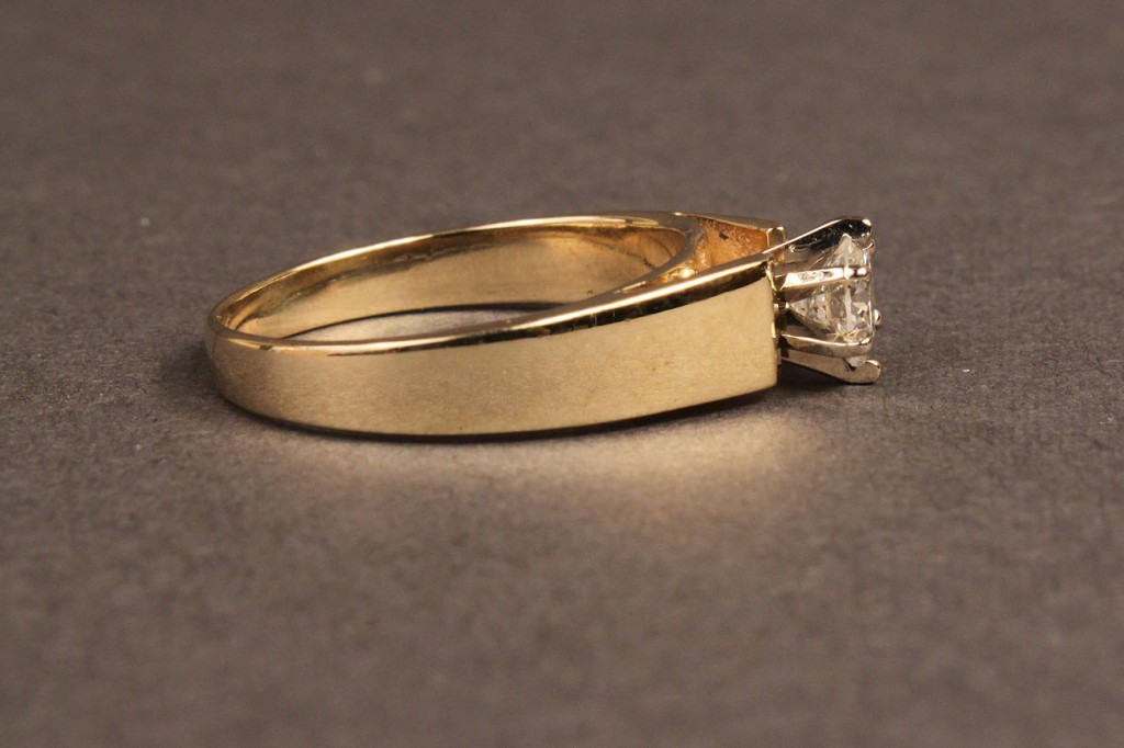 Lot 101A: One-half Carat Diamond solitaire ring, 14K gold