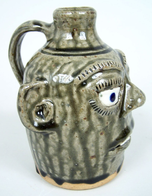 Southern folk pottery face jug by A. G. Meaders (lot#221)