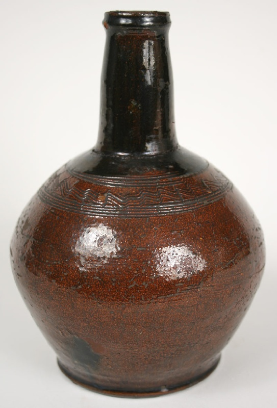 Rare redware bottle, attributed to Cain Pottery, East Tennessee