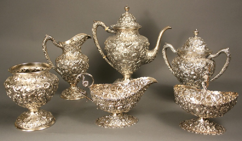 An Important repousse silver tea set, gravy boat marked G. R. Calhoun