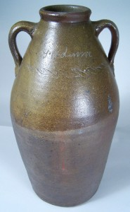 "Lot 18: Middle Tennessee stoneware jar, signed in script ""G W Dunn"", sine wave incising"