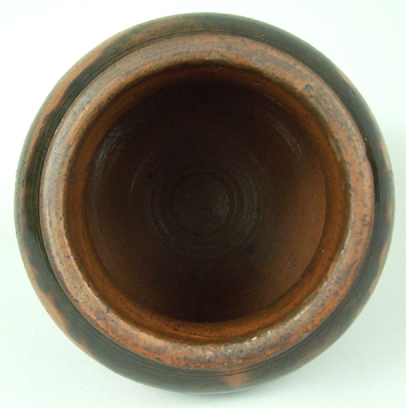 Lot 100: Greene County, Tennessee redware jar attributed to C A Haun