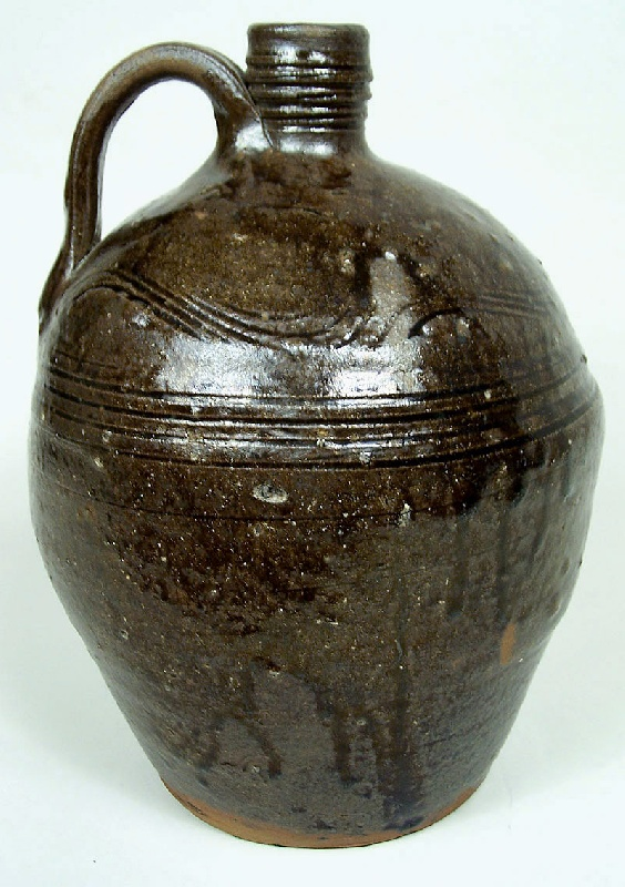Early and rare North Carolina alkaline glazed pottery jug with sine wave incising (lot#43)