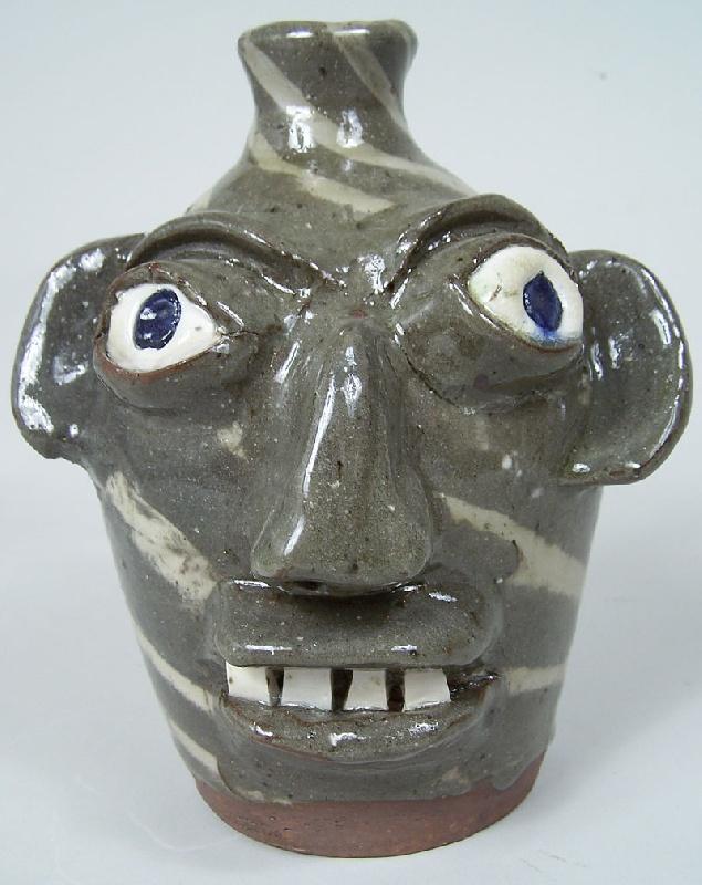 Southern folk pottery face jug, B B Craig (lot#230)