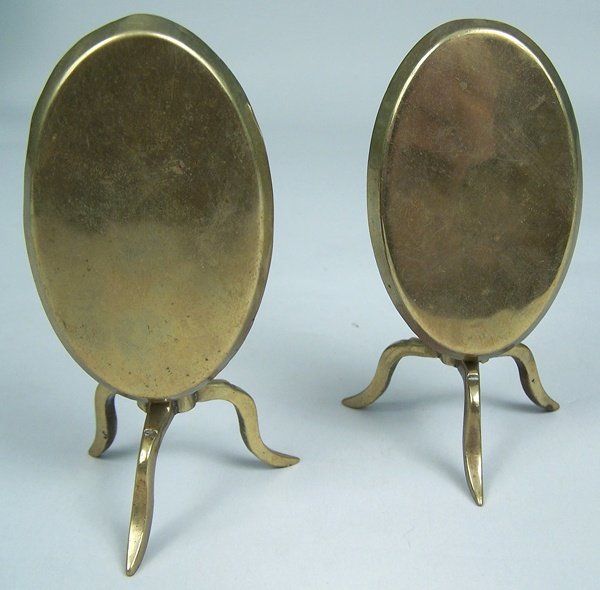 Pair of English brass candle reflectors in a candlestand form