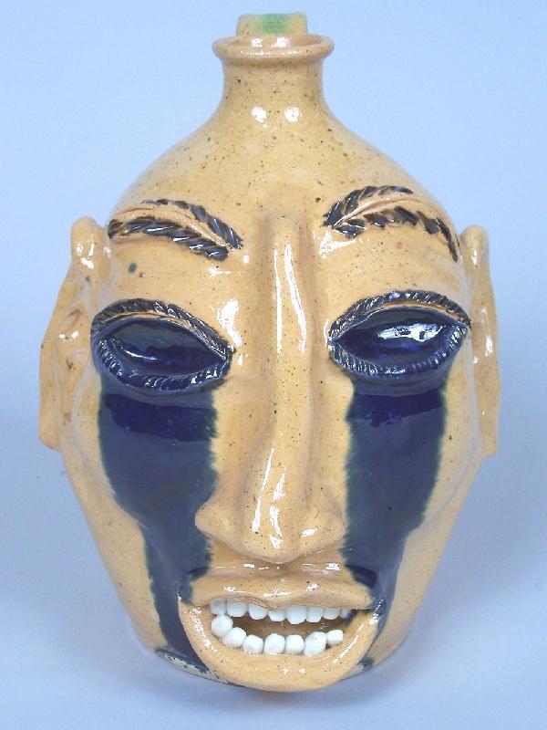 Southern folk pottery face jug by Billy Ray Hussey (lot#229)