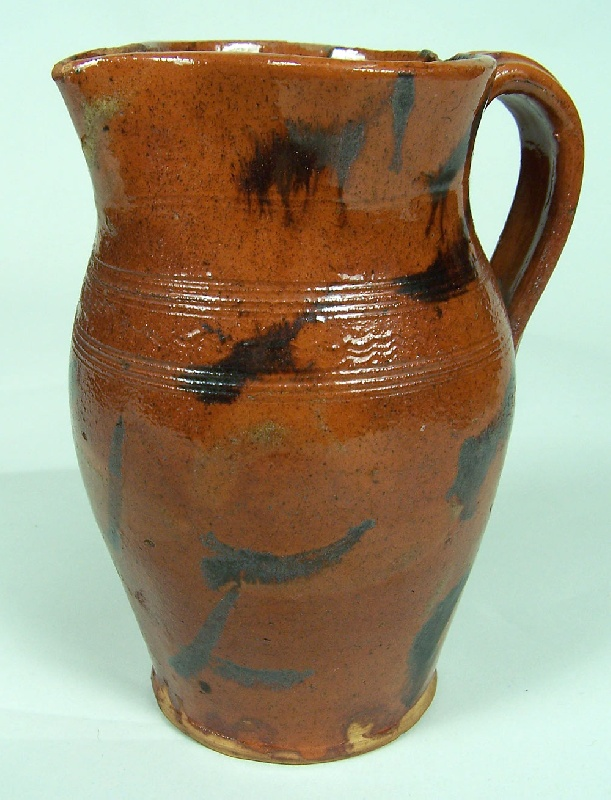 An exceptional East Tennessee redware pitcher, attributed to Cain pottery (lot#101)