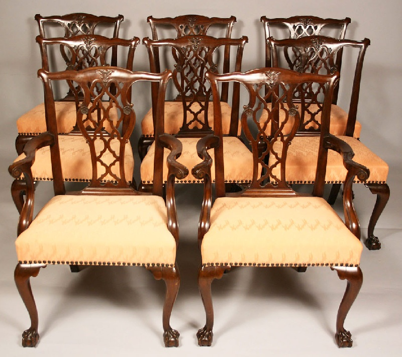 Set of eight Chippendale style carved chairs, including two arm chairs