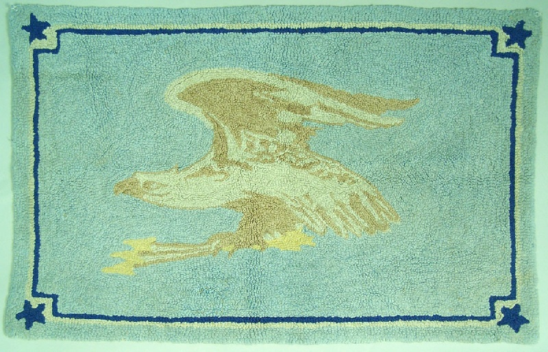 Hooked rug with American eagle holding arrows in talons (lot#181)