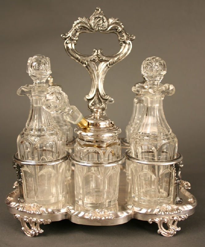 Rare and Early English cruet set with flint glass bottles.