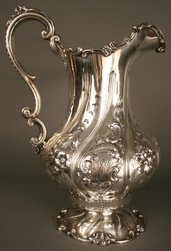 Large Gorham sterling silver water pitcher in the Rococco style with flowers and cartouche design. Gorham hallmarks.