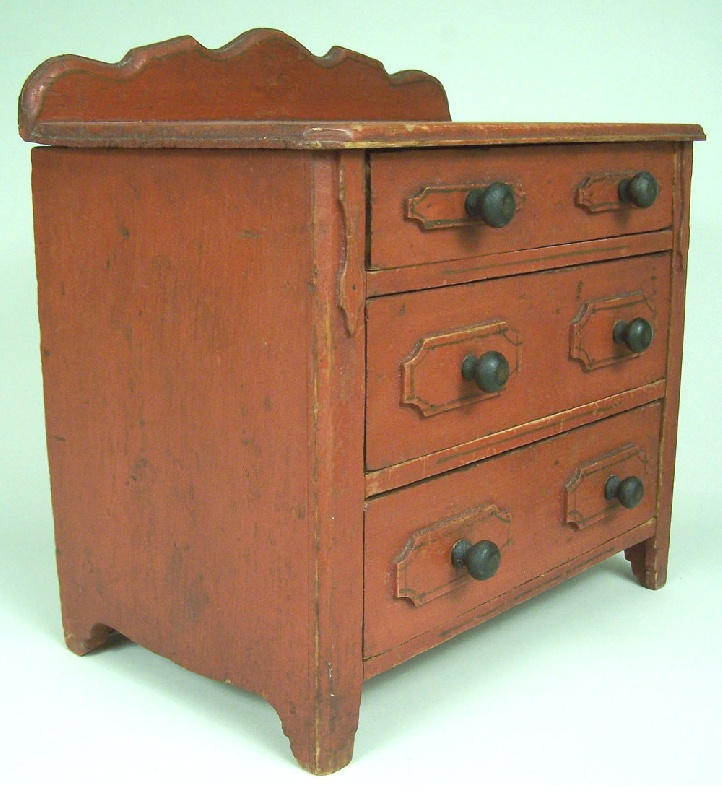 Red painted miniature three drawer chest (lot#206)